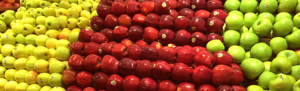 Stacked apple varieties in a market